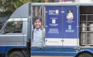 Corporation Bank donates meal delivery vehicle