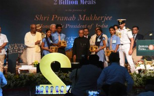 Shri Pranab Mukherjee, Honourable President of India, poses with beneficiary school children after symbolic sweet distribution